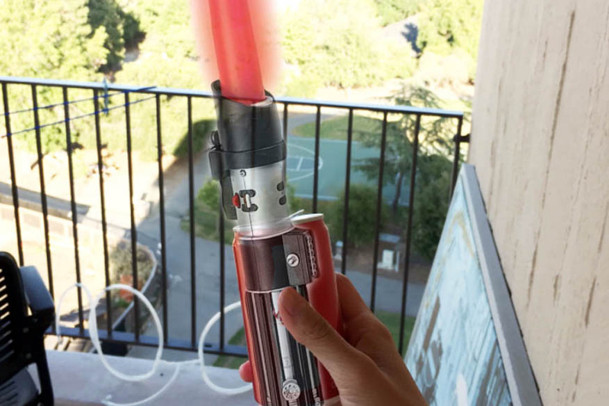 lightsaber overlayed over a can of coke.